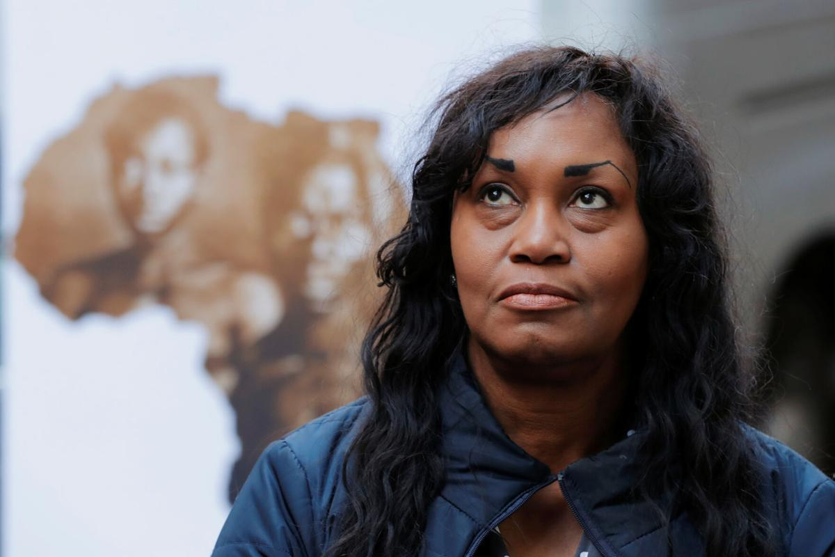Tamara Lanier listens as her lawyer speaks to the media outside of the Harvard Club in New York