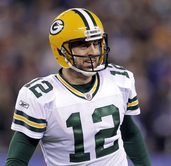 Rodgers keeps Packers perfect with late rally