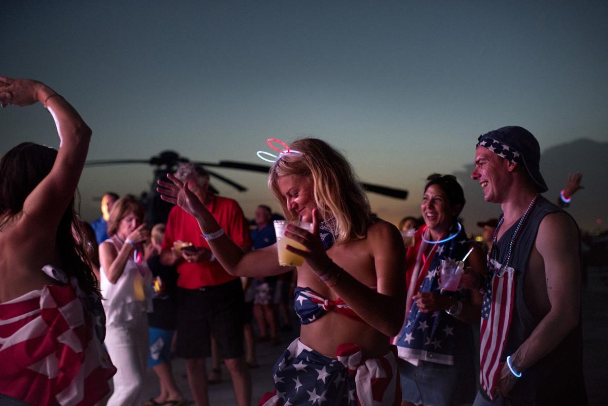 People dancing on Yorktown in July 4th get-ups