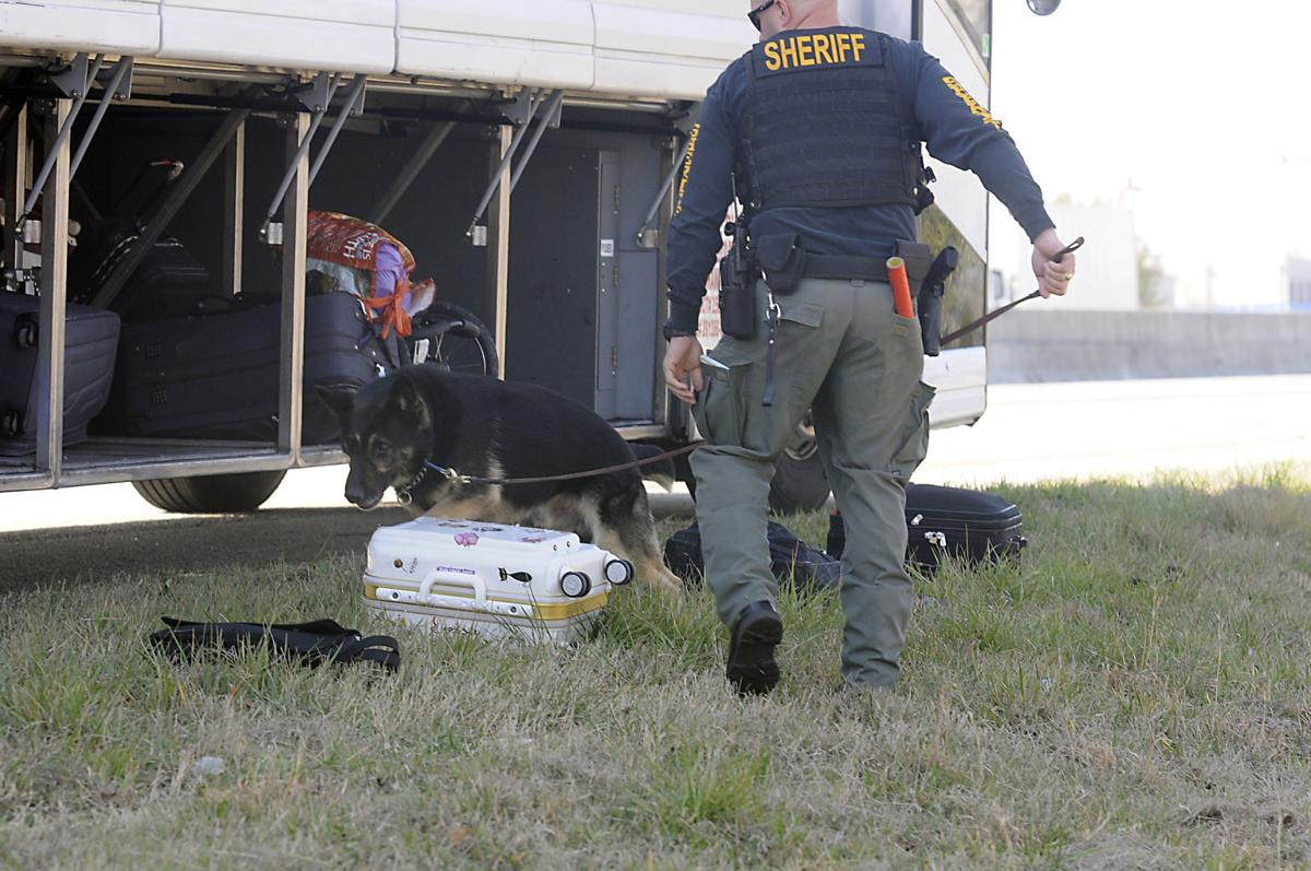 A traffic stop leads to inspection of luggage on an inter-city bus