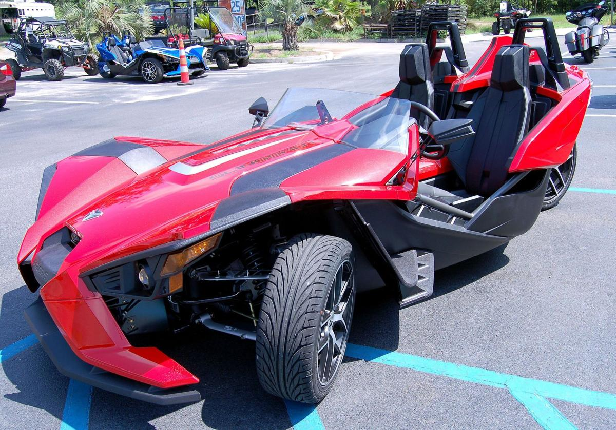 Spin cycle Slingshot rides down road with three-wheeled traction, four-cylinder power