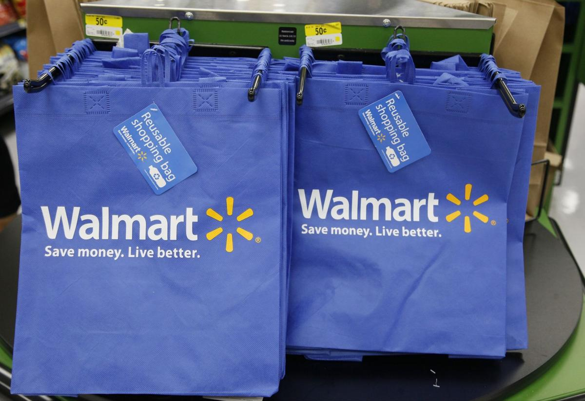 Wal-Mart profit falls as it pays for costly revamp