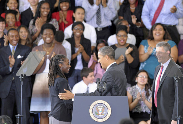 Obama urges students to find new passions