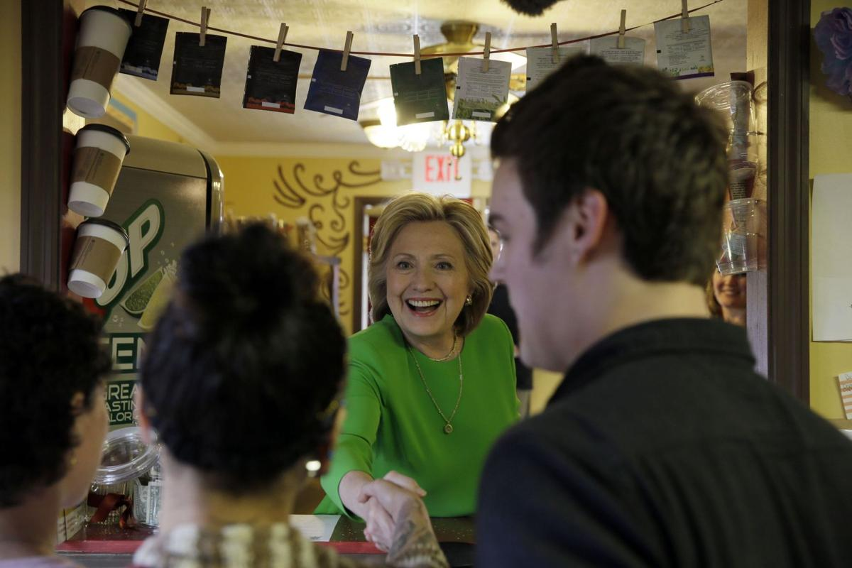 Clinton stops at Iowa coffee shop to kick off 2016 campaign