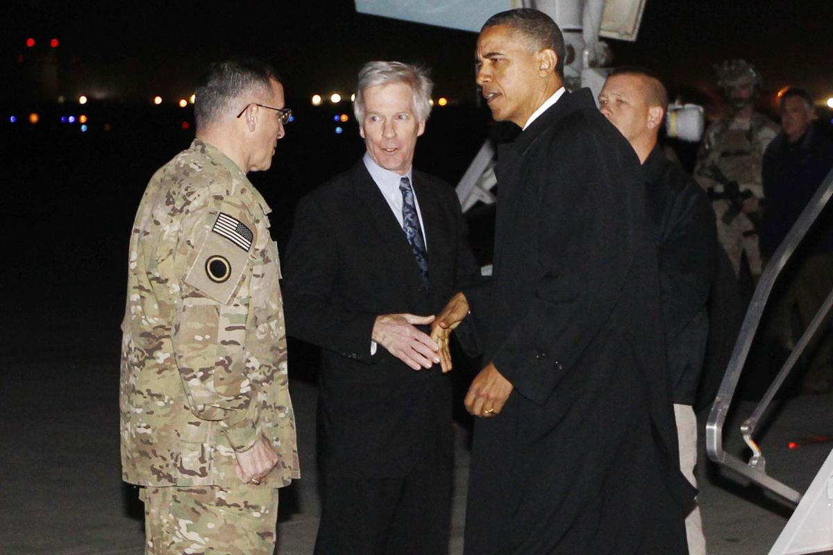 Obama signs security pact in Afghanistan on anniversary of Bin Laden's demise