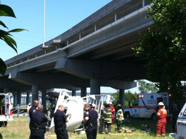 Utility truck plunges from overpass in Charleston near Morrison Drive and Huger Street