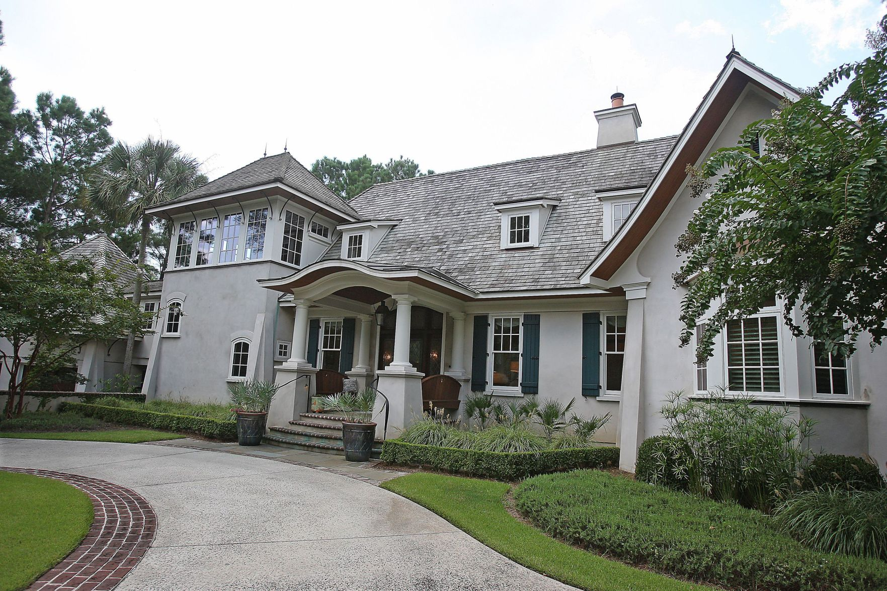 158 Nicholas Carteret Circle Columned Home With European Feel Offers Pool,  Gardens, Lagoonside Setting