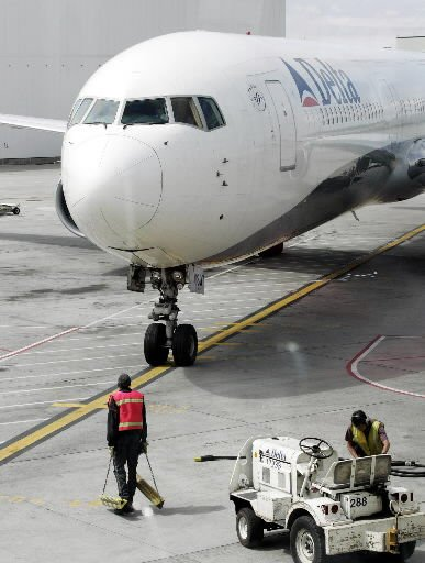 Delta scales back bag check fee