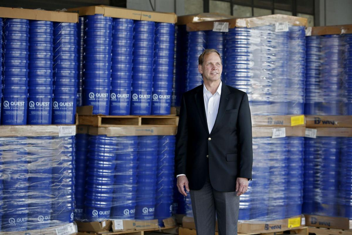 Quest sells 2 divisions to Valspar Corp.