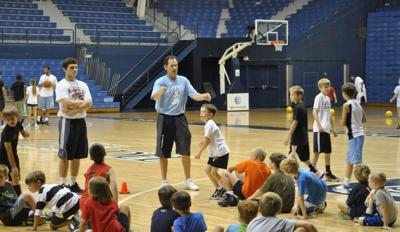 Local youths hoop it up at summer camps Players learn basketball fundamentals