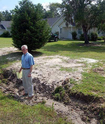 18 months later, church struggles to fix ditch