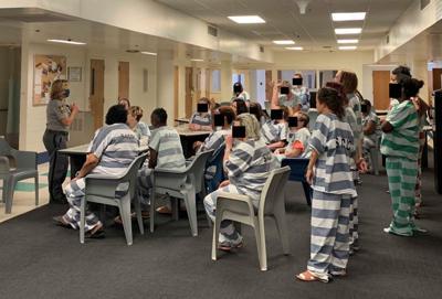Sheriff Kristin Graziano with inmates