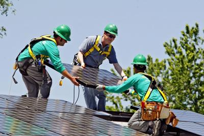 Elon Musk takes on carbon with solar, battery betsAP Photo NYBZ128 (copy)