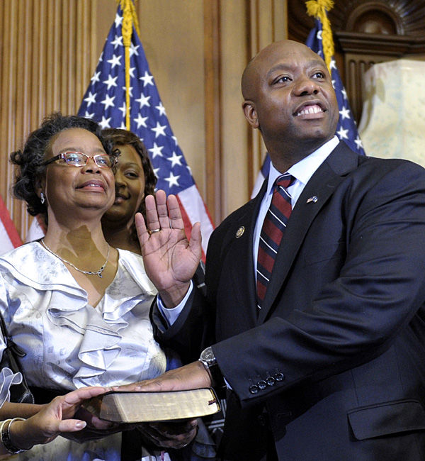 Scott sworn in, vows effort to try to repeal health care law