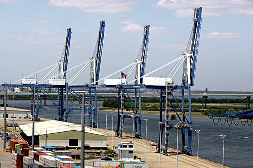 Port volume soars for July, but caution is urged