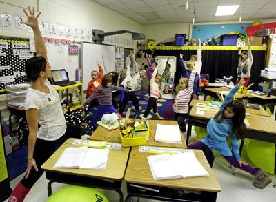 Yoga in classrooms Instructors bring ever-popular practice into local schools, minus the religion