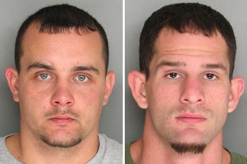2 charged in stolen guns case