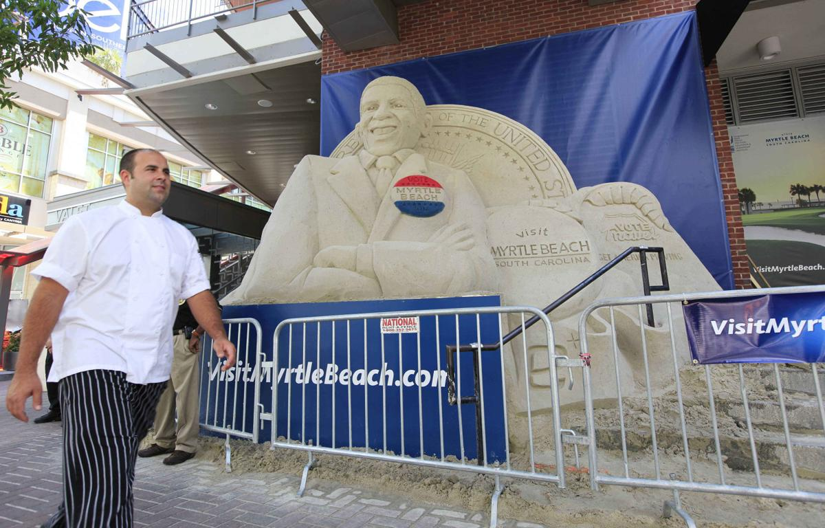 Giant Obama sand sculpture stands near convention
