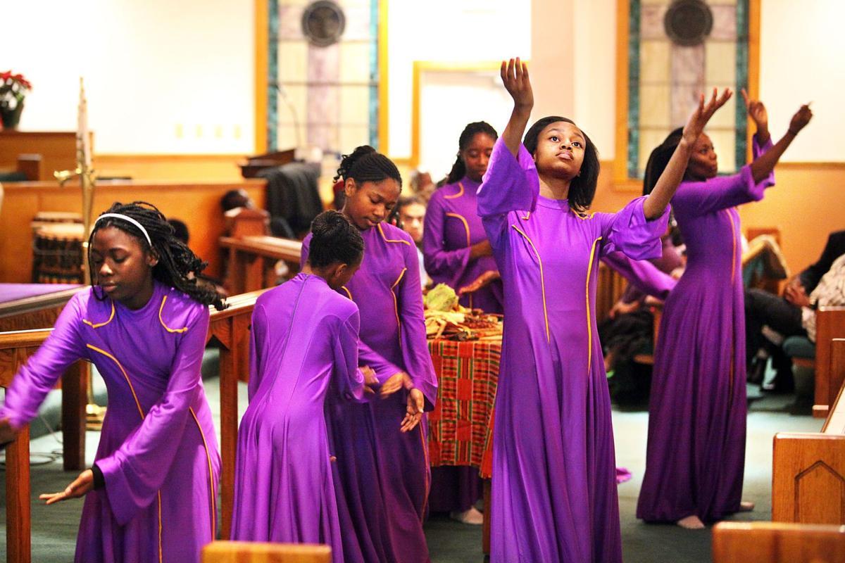 'Life-changing' Kwanzaa begins - girls in church