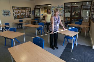 Virus Outbreak Britain Schools Reopening