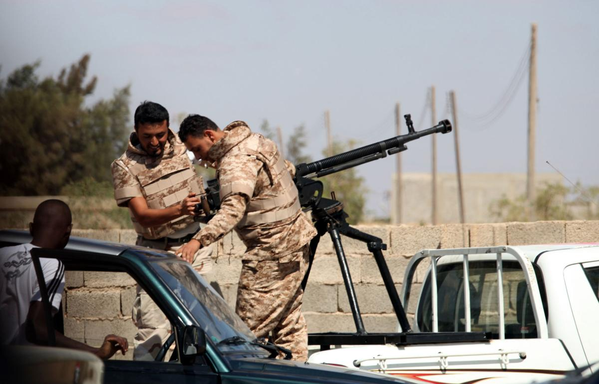 Libya orders militias to submit or disband