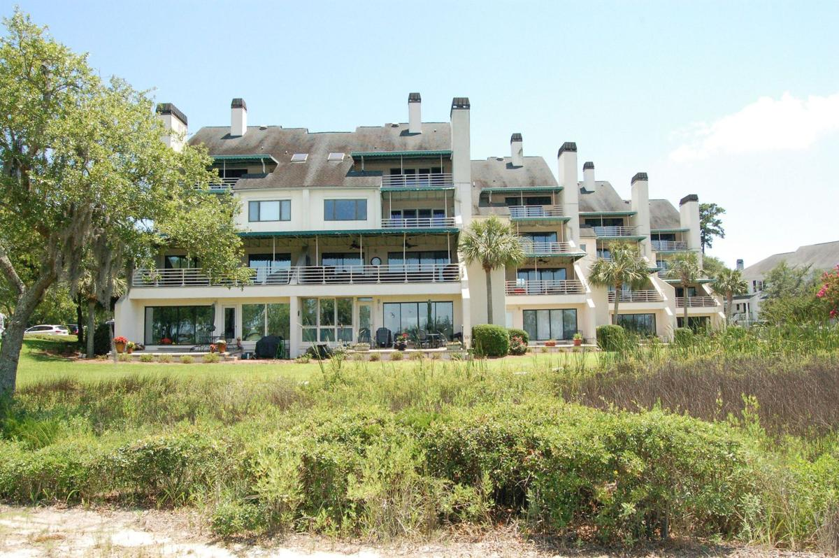 150 Wappoo Creek Drive, Unit 14 - Updated James Island condo yards from water showcases close-in views, multilevel interior