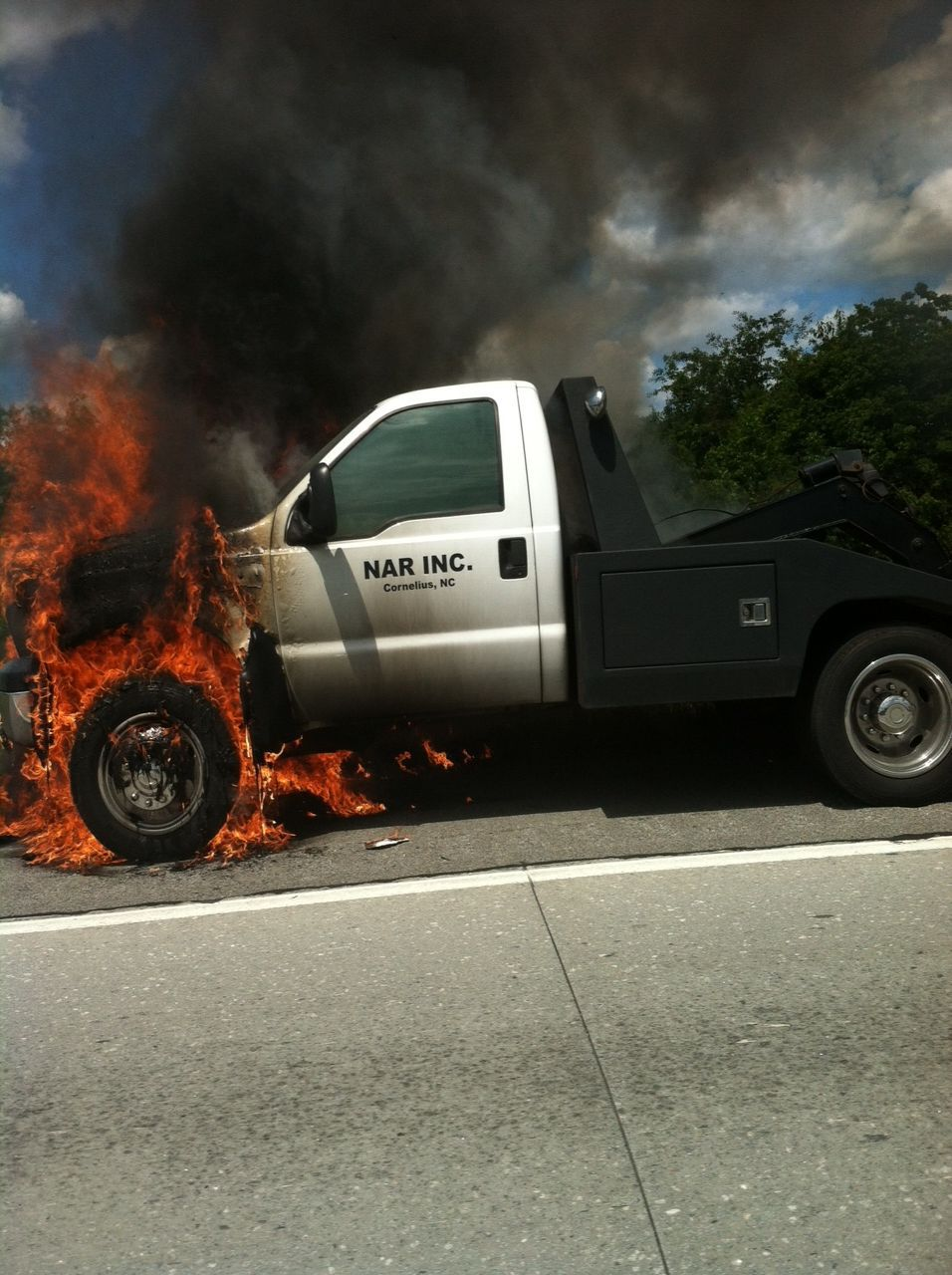 Tow truck bursts into flames while towing disabled vehicle on I-26
