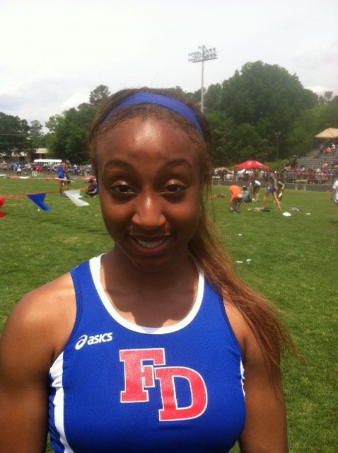 Quinn breaks state hurdles record, Loy owns discus mark