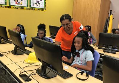 Y Girls Code in computer Lab