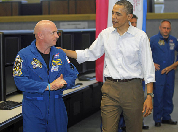Shuttle flight is delayed; Obama visits Giffords