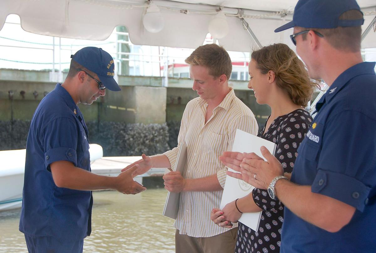 Charleston City Marina employees who rescued two men in May honored by Coast Guard at ceremony