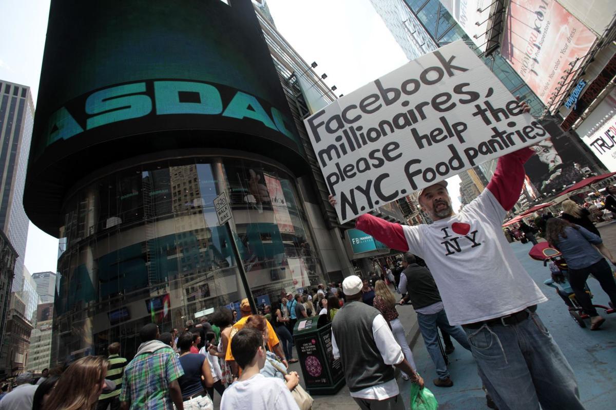 Zuckerberg's fortune up $100 million even as Facebook's debut stalls