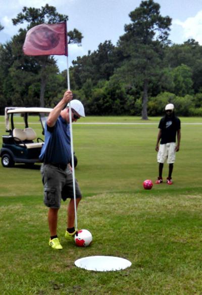 Soccer + golf equals 'Footgolf'