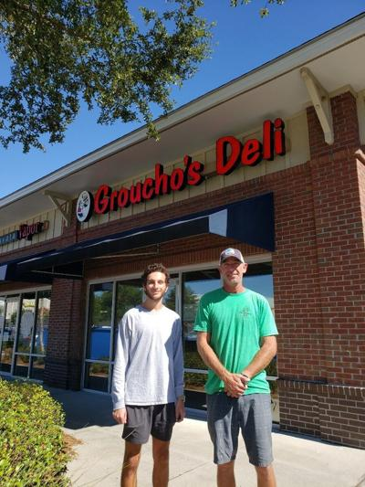 Owner Bryan Baxter (right) with Max Miller (left) of Groucho's Deli