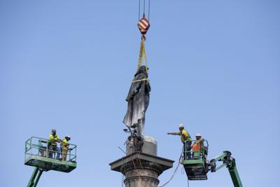 workers by statue.jpg (copy) (copy)