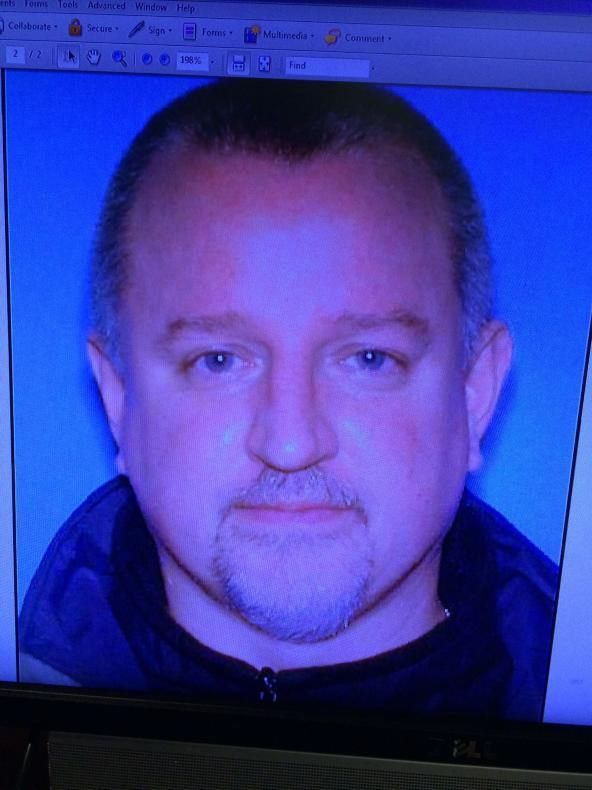 Man charged in estranged wife's death; 2 boys safe