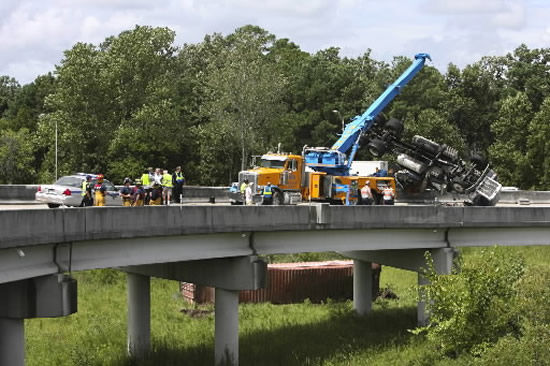 Tractor trailer wrecks on I-26, drives off ramp