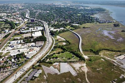 Reclaiming the Neck, again; Ashley River waterfront gets a second look from MeadWestvacoAddressing a century of pollution $100 million and countless tons of dirt leave the Ashley riverfront cleaner, safer