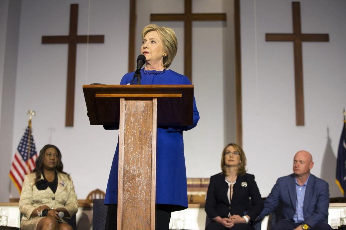 Clinton calls for probes of police-involved deaths