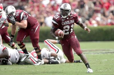 Lattimore carries load for No. 13 Gamecocks