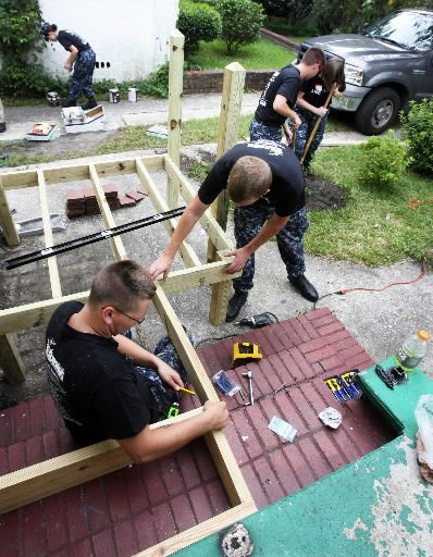 Early Day of Caring effort sees sailors ramp up neighborhood