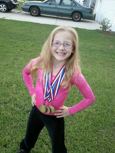 Wolf triumphs in state gymnastics meet