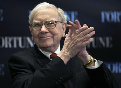 Buffett says economy still improving slowly