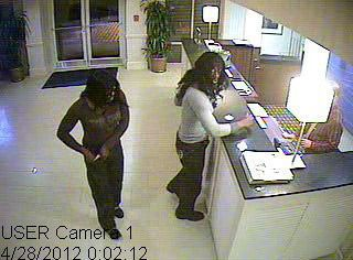 Would-be robbers who dressed as women sought