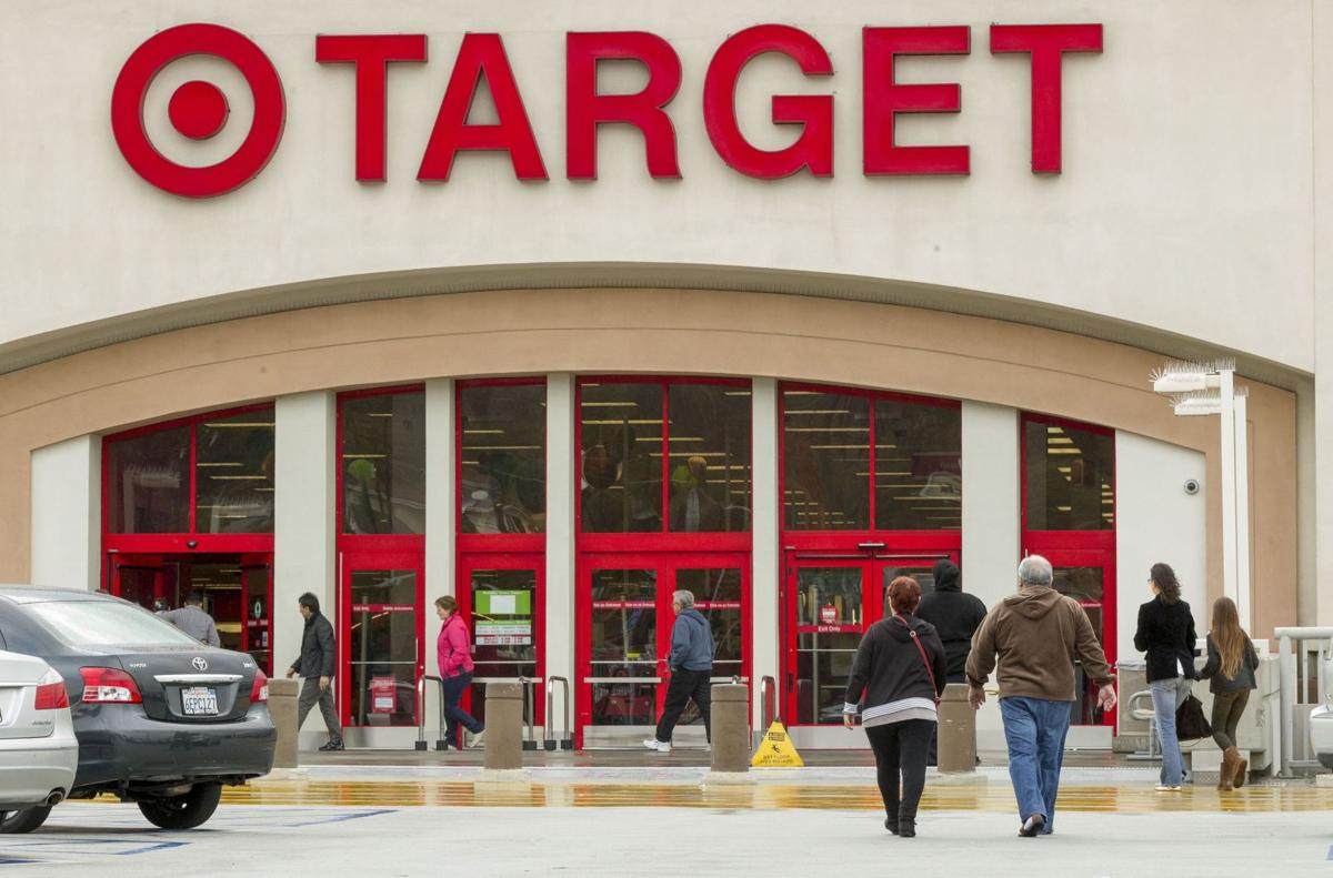 Target 1Q profit falls 16 pct as breach takes toll