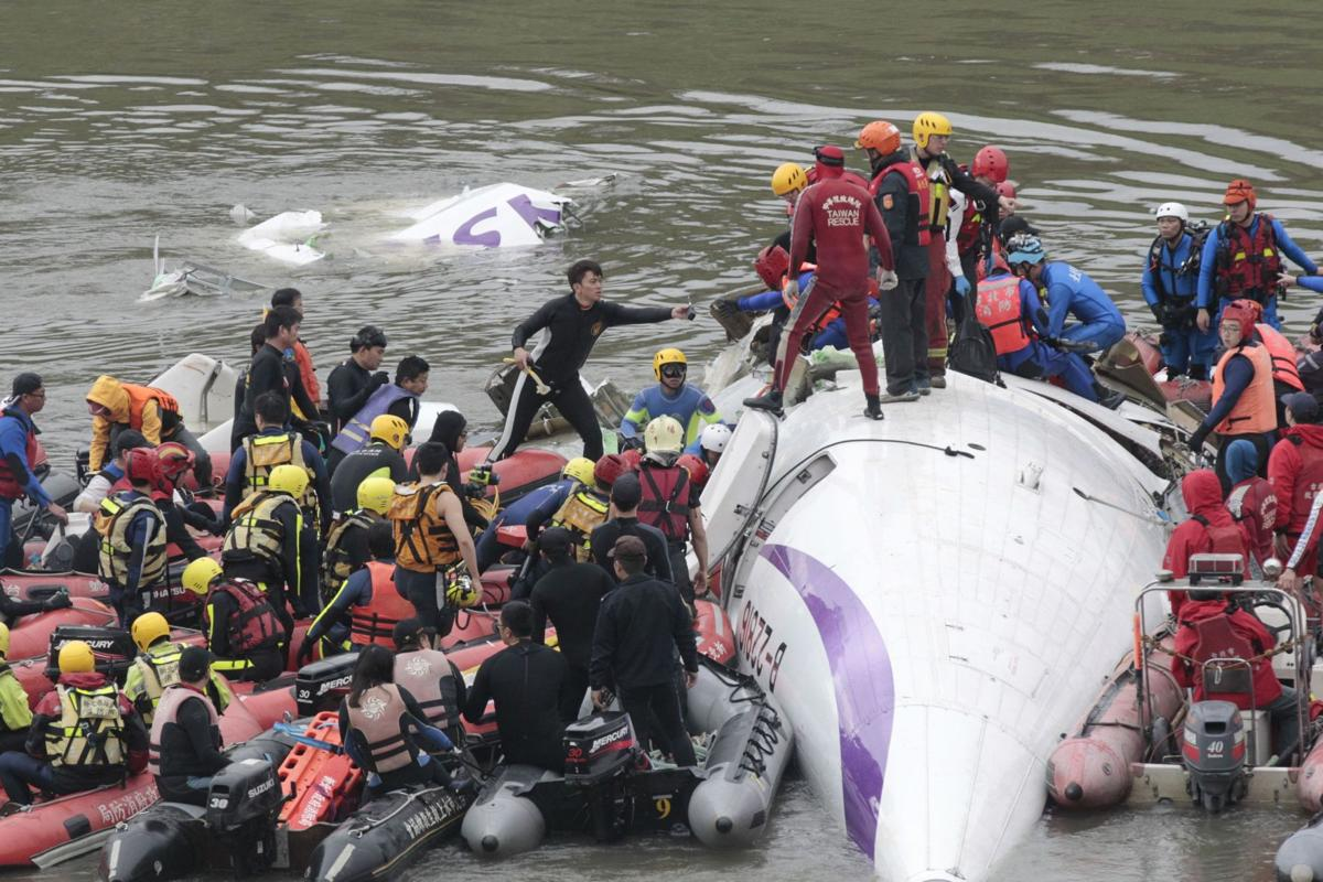 Crashed Taiwan plane hoisted from river; 26 confirmed dead