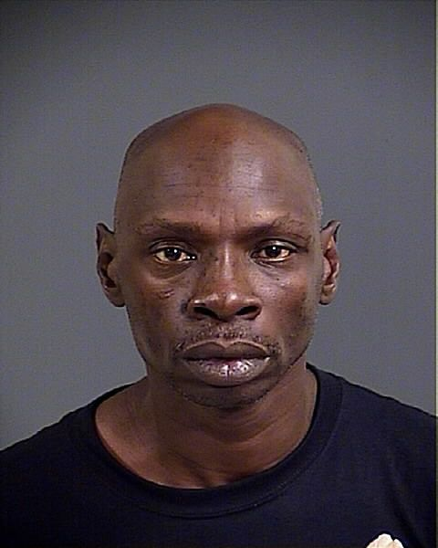 Man accused of using broken champagne bottle in gas station robbery