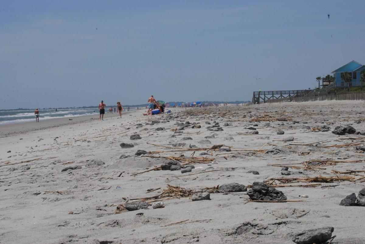 Between a rock and a hard place: Folly renourishment leaves beach littered with debris that can stub toes