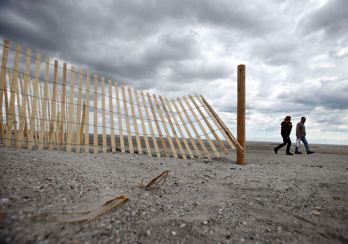 Why are so many fences going up at Folly Beach? Sand-trapping slats to help build dunes as part of renourishment