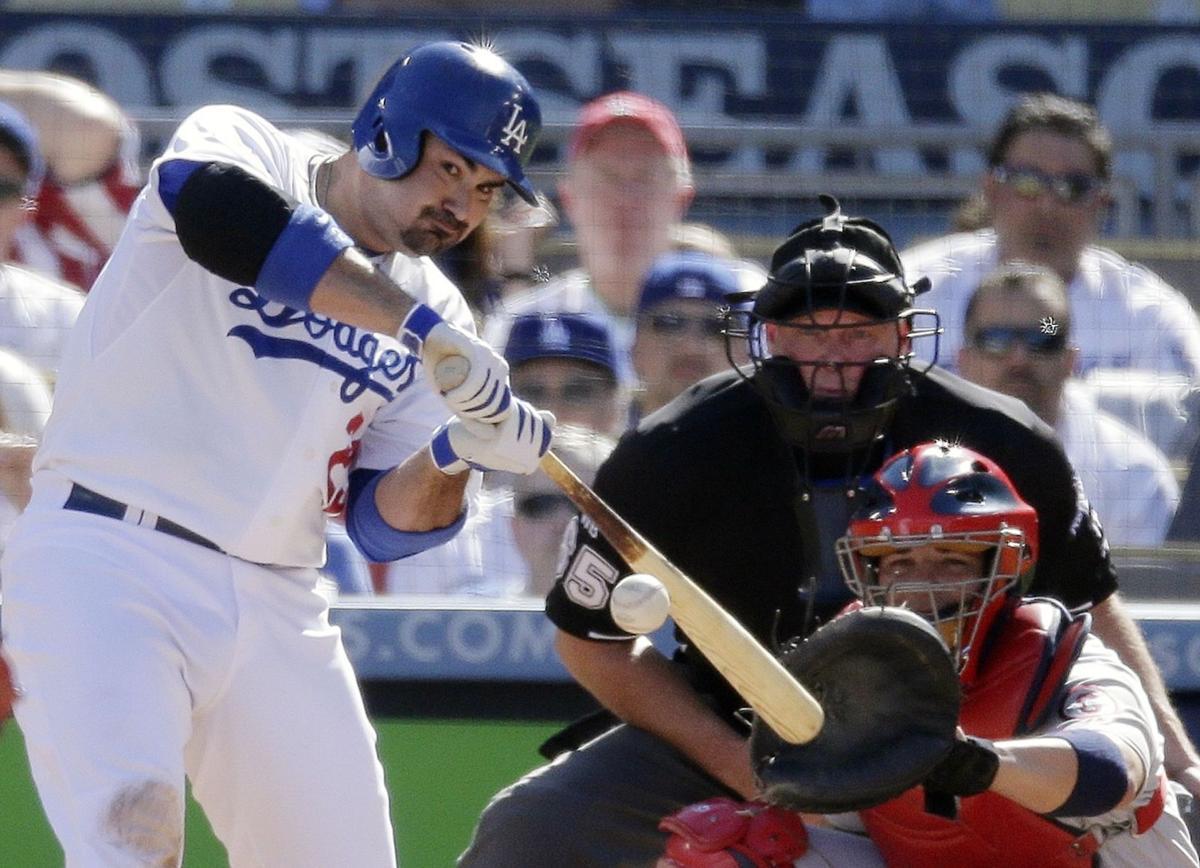 Gonzalez helps Dodgers stay alive